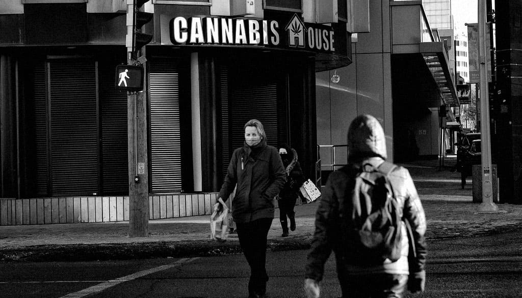 People in the street next to cannabies store